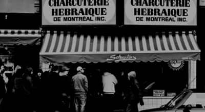 An old-time lineup outside Schwartz's Deli in Montreal. Centaur Theatre will produce a musical about the Montreal landmark.