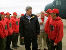 Prime Minister Stephen Harper is greeted by Arctic Rangers as he arrives in Resolute Bay on Friday.