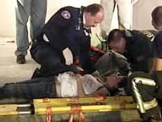 A teenager was taken away by a stretcher outside Central Heights Church after its floor caved in late Friday night during a packed rock concert.