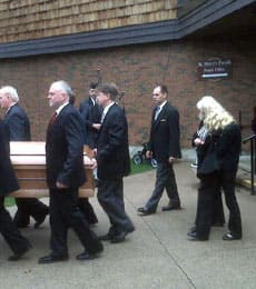 Brandon Crisp's casket is carried out of St. Mary's Church in Barrie, Ont., on Nov. 14, 2008.