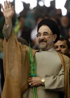 Former Iranian President Mohammad Khatami, seen here at a pro-Mousavi rally in May, accused the ruling government on Wednesday of 'staging a velvet coup against the people and democracy.'