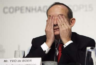 The UN's climate change chief Yvo de Boer shows signs of fatigue at a press conference in Copenhagen in December.