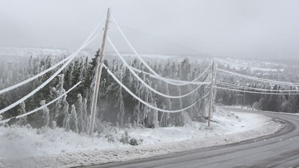 Ice-laden power lines near Conception Bay North, N.L., on Saturday. About 7,000 customers remained without power in northeastern Newfoundland on Sunday after a severe ice storm hit the area Friday.