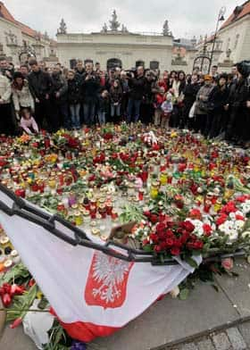 People mourn in front of the presidential palace in Warsaw on  Saturday.