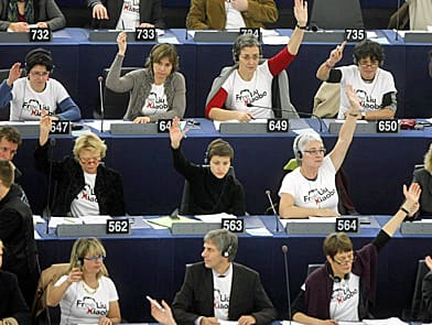 The whole world is watching. Here, Green party members of the European Parliament wear T-shirts that reads free Liu Xiaobo during a vote in Strasbourg, eastern France, in November 2010. (Christian Lutz/Associated Press)
