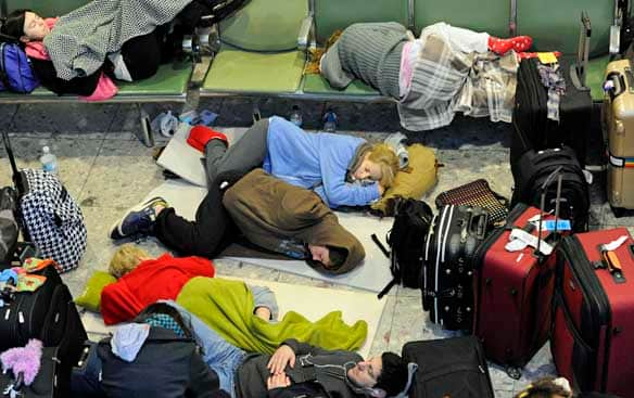 Passengers sleep on makeshift beds in Terminal 3 at Heathrow Airport in London on Tuesday.