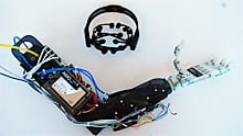 The Artificial Muscle-Operated (AMO) Arm has a headset that picks up electrical signals from the brain.