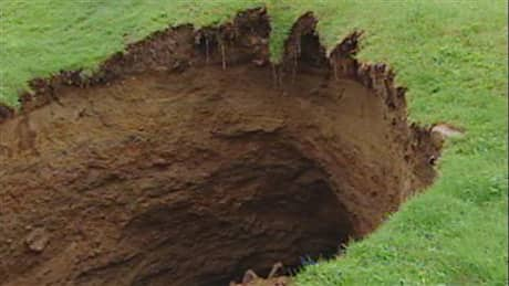 Experts are examining several ground holes that have appeared in Quebec City's Charlesbourg's district.