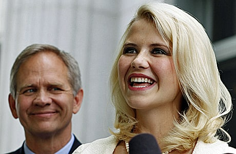 Elizabeth Smart and her father, Ed Smart, talk to the media in front of the Frank E. Moss Federal Courthouse on May 25, 2011, in Salt Lake City.