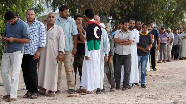 People stand in line to see the body of former Libyan leader Moammar Gadhafi in Misrata.