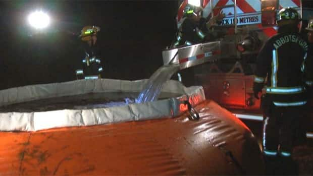 Abbotsford firefighters had to truck in water from the city's airport to fight a wood-chip fire Thursday night.