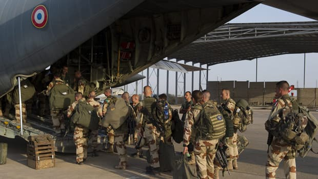 French soldiers of the 21st Marine Infantry Regiment board a plane to Bamako, the capital from Mali, at the N'Djamena's airport, in Chad on Jan. 11