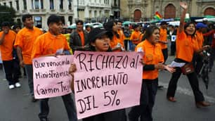 'I reject the five per cent increase,' says a La Paz  demonstrator's sign denouncing the size of Bolivia's proposed  minimum-wage increase.