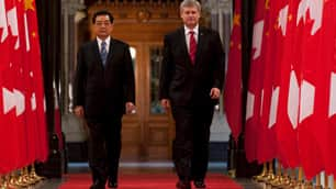Prime Minister Stephen Harper, right, walks with Chinese President Hu Jintao through the Hall of Honour on Parliament Hill in Ottawa on June 24, the day the two signed an agreement giving Canada 'approved destination' status.