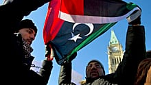 Libyan nationals protest on Parliament Hill in Ottawa Monday.