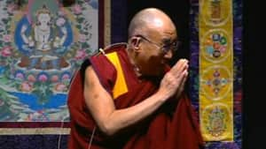 The Dalai Lama addresses a packed crowd at the Civic Centre on Saturday morning.