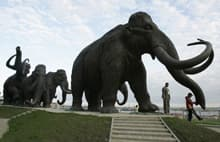 A sculpture of mammoths in the Siberian town of Khanty-Mansiisk. Wooly mammoths are thought to have died out around 10,000 years ago.