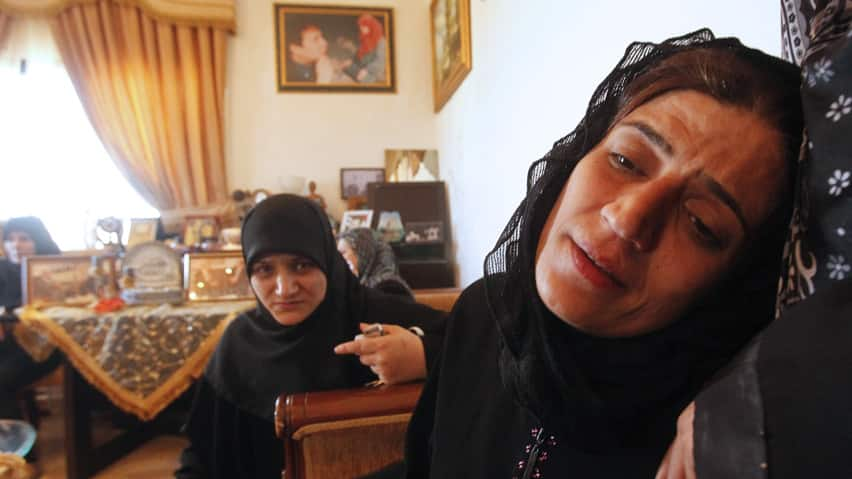 Siham, wife of Mohammad Darro Jamo, is shown mourning his death earlier this week. A security source told Reuters that authorities now believe the wife had arranged her husband's killing because she was angry over alleged infidelities.