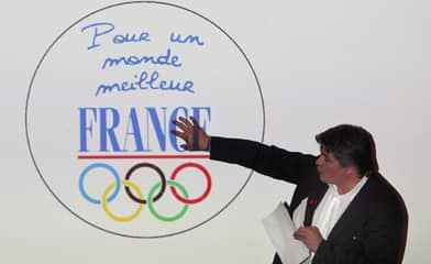Several French athletes want to wear a badge that says 'For a better world' in French at the Beijing Olympics, in response to China's crackdown in Tibet.