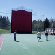 The court in Trois-Pistoles is so busy, Pettigrew often trains after midnight. Above, an afternoon game between local players.