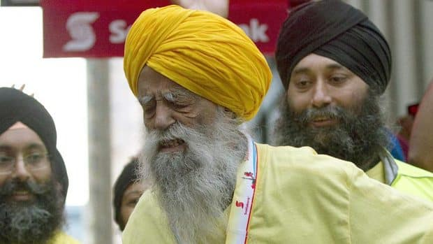 Fauja Singh as he crosses the line at the Toronto Waterfront Marathon