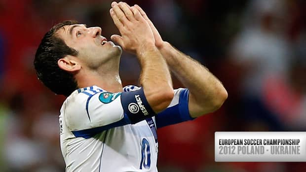 Greece's Giorgos Karagounis celebrates his first-half goal against Russia Saturday in Warsaw, Poland.