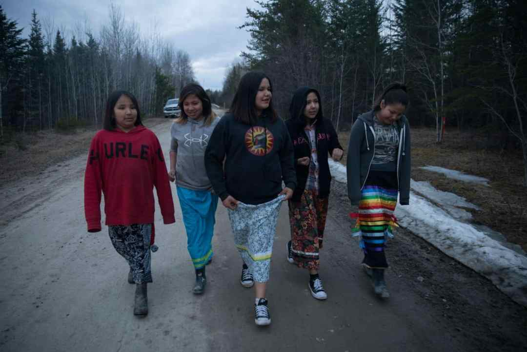 Girls in traditional Anishinaabe ribbon skirts head to a traditional ceremony. (Ed Ou/CBC)