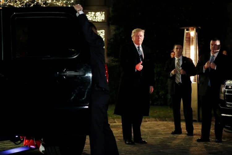 Donald Trump arrives at a party at the home of Robert Mercer on Dec. 3, 2016, less than a month after winning the presidency. (Mark Kauzlarich/Reuters)