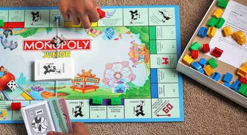 Top 10 Favourite Family Board Games   Play   CBC Parents Player reaches across the monopoly board game