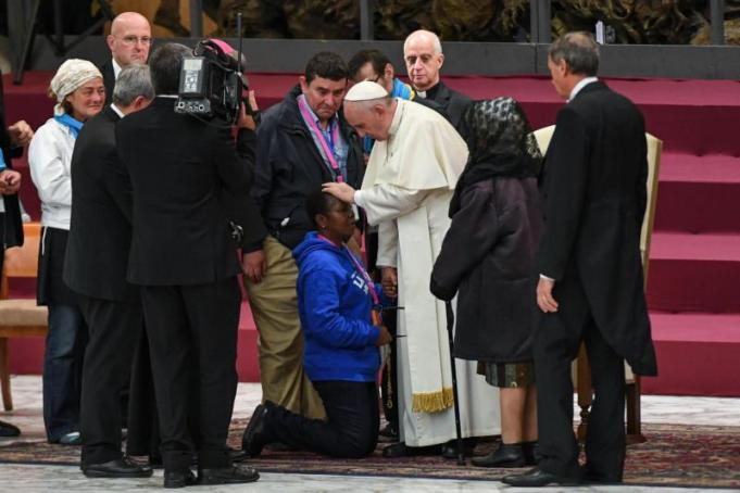 Pope Francis blesses a pilgrim during a special audience with homeless people in Paul VI hall at the Vatican, Nov.11. (CNS photo/Alessandro Di Meo, EPA) See POPE-JUBILEE-HOMELESS Nov. 11, 2016.