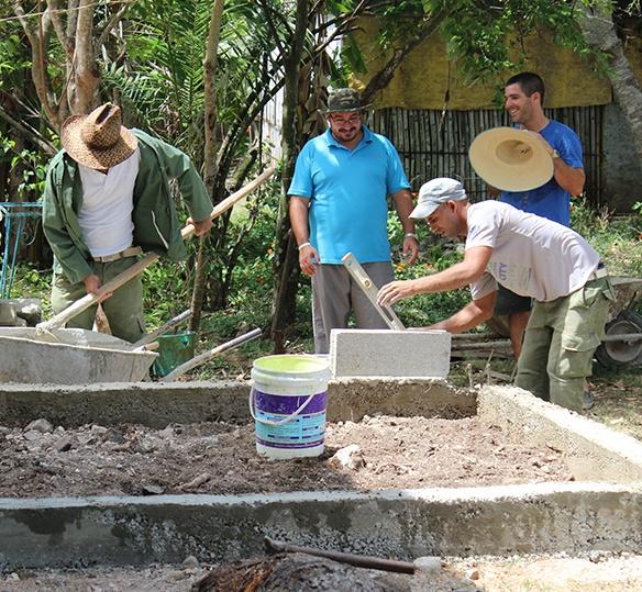 Photo of Cuban men doing construction work