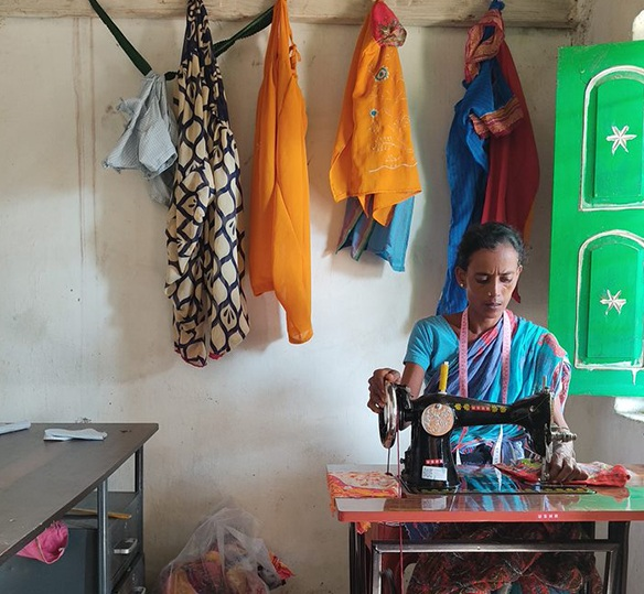 Photo of an Indian women sewing