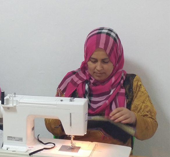 photo of Lebanese women using a sewing machine