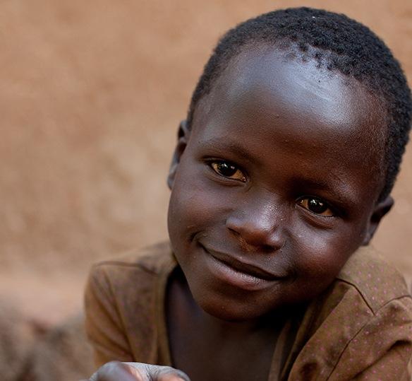 Photo of a young Rwandan boy smiling
