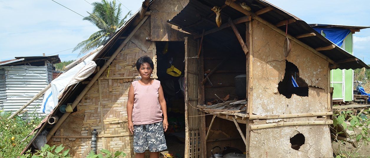 Photo of a woman by a shanty