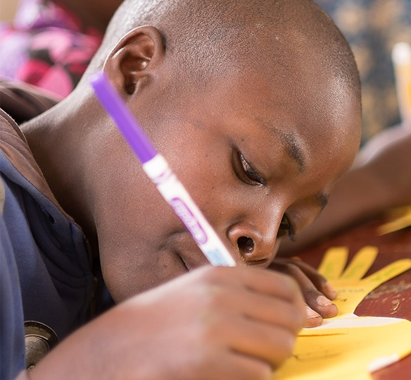 Photo of African boy writing