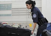 CBP Officer Inspecting Luggage