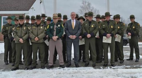 New Hampshire State Commissioner of Public Safety John J. Barthelmes (center) Chief Patrol Agent John C. Pfeifer with New Hampshire State Police Trooper Gary Prince, Fish & Game Officers and Beecher Falls Border Patrol Agents. Photo Credit: The News and Sentinel, Colebrook, N.H.