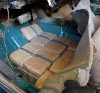 Offices at the Port of Douglas located packages of marijuana when they pulled back the carpeting inside of a smuggling vehicle