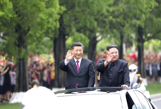 Image result for North Korea's official news agency released still photographs of China's President Xi Jinping's meet Kim Jong Un in Pyongyang.