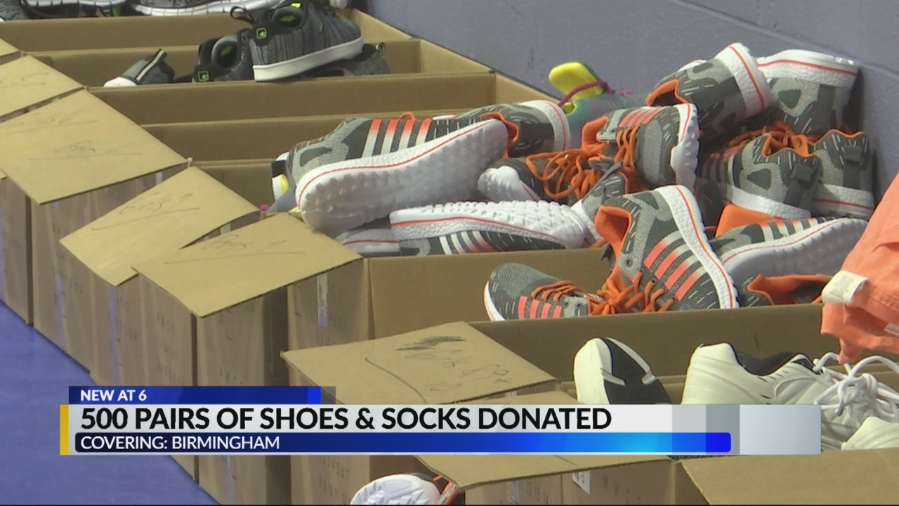 500 pairs of socks and shoes donated