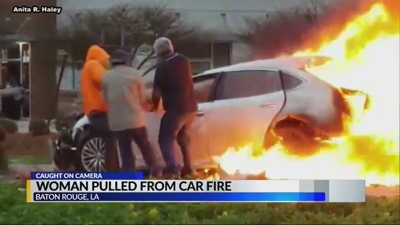 Woman pulled from car fire