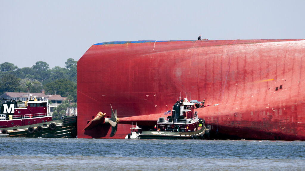 Rescuers pull out men trapped inside capsized cargo ship   WIAT
