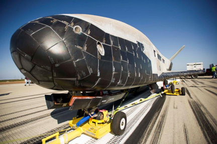 Looking none the worse for its 469 days in space, the X-37B is prepared for a tow to the hangar. (Credit: U.S Air Force)