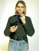 photo of kurt cobain smoking a cigaret and holding a gun