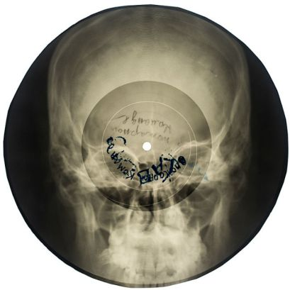 x-ray of a skull transformed into a a vinyl record