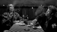 iggy pop and tom waits having a coffee and smoking a cigarette