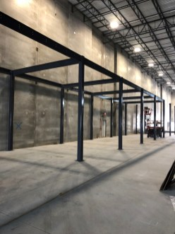 Pre-fabricated steel mezzanines us bolt-together support structures.