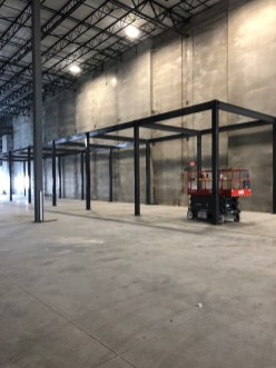 Pre-fabricated steel mezzanines are free-standing. They only attach to the building's floor.