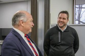 Mayor Clough greets fellow St. Edward's Alumnus, Dave Gareau, Director of Operations